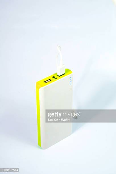 Close-Up Of Power Bank Over White Background