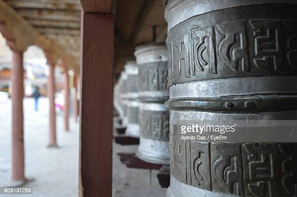Close-Up Of Prayer Wheels In Temple