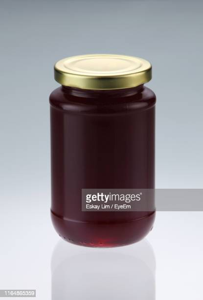 close-up of preserves in jar on white background - jar stock pictures, royalty-free photos & images