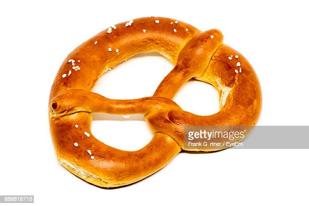 Close-Up Of Pretzel On White Background