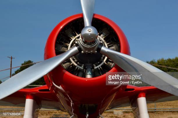 close-up of propeller airplane against sky - propeller stock pictures, royalty-free photos & images