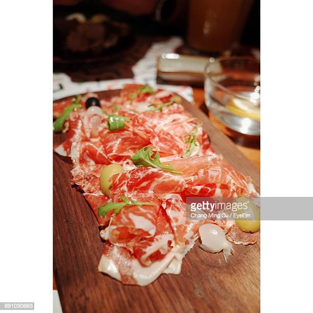 Close-Up Of Prosciutto On Table