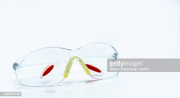 close-up of protective eyewear on white background - eye protection stock pictures, royalty-free photos & images
