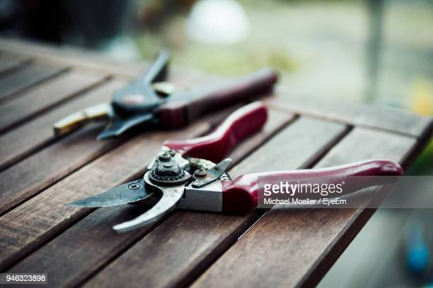close-up of pruning shears on table - pruning shears stock photos and pictures