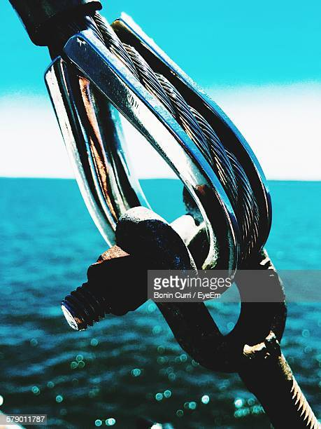 Close-Up Of Pulley By Sea Against Sky