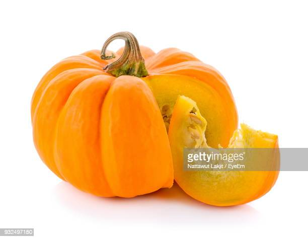 close-up of pumpkin against white background - pumpkin stock pictures, royalty-free photos & images