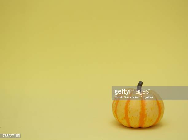 Close-Up Of Pumpkin Against Yellow Background