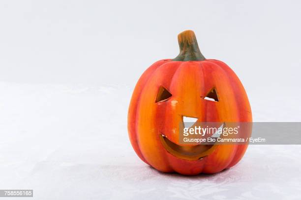 close-up of pumpkin during halloween against orange background - cammarata stock photos and pictures