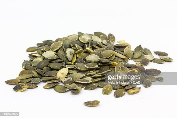 Close-Up Of Pumpkin Seeds Over White Background