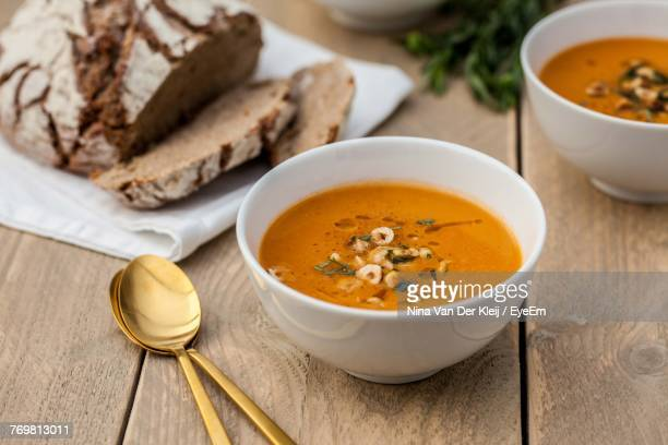 Close-Up Of Pumpkin Soup In Bowl On Wooden Table
