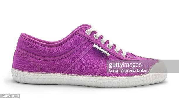 close-up of purple canvas shoe over white background - purple shoe stock pictures, royalty-free photos & images