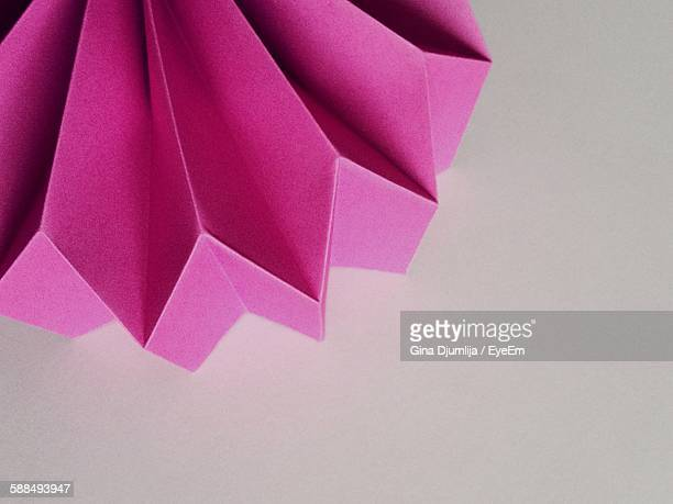 Close-Up Of Purple Paper Art On Table