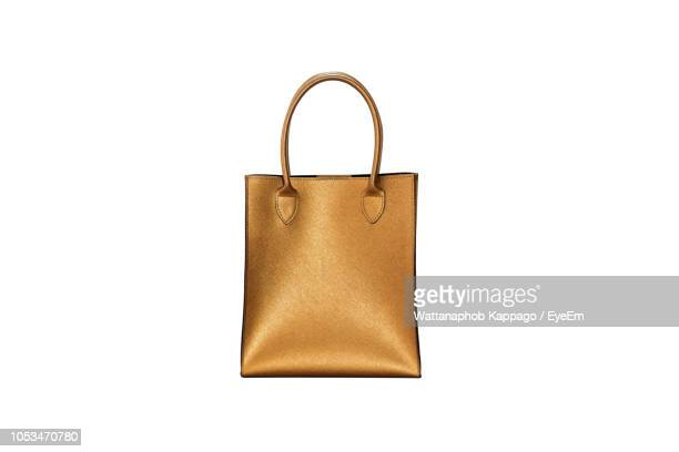 close-up of purse against white background - accessoires stock-fotos und bilder