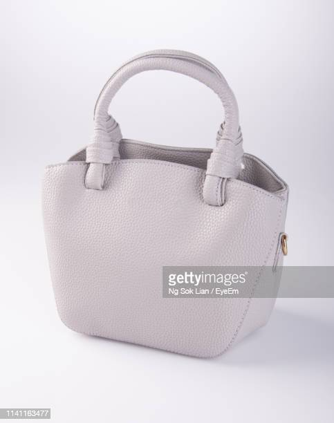 close-up of purse against white background - leather purse stock pictures, royalty-free photos & images