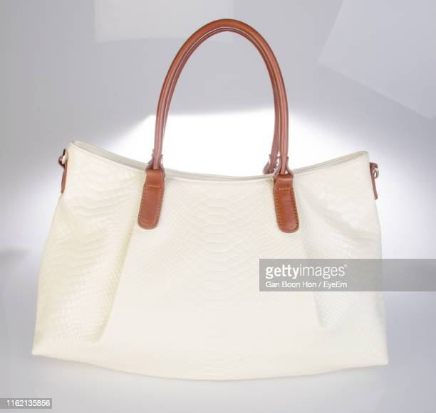 close-up of purse against white background - handbag stock pictures, royalty-free photos & images