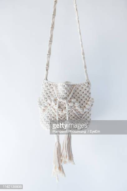 close-up of purse against white background - white purse stock pictures, royalty-free photos & images