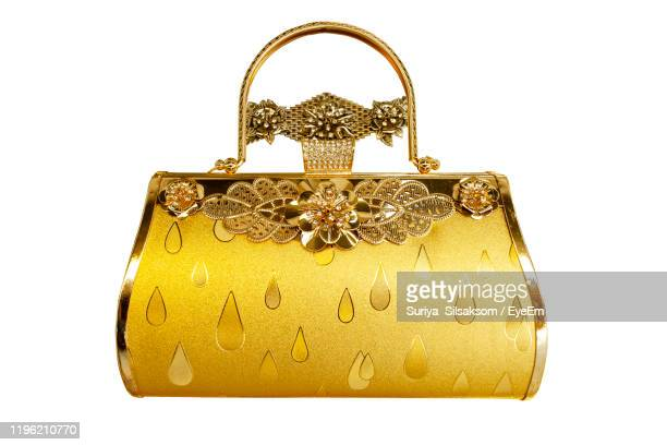 close-up of purse against white background - gold purse stock pictures, royalty-free photos & images