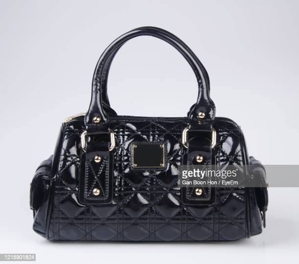 close-up of purse against white background - black purse stock pictures, royalty-free photos & images