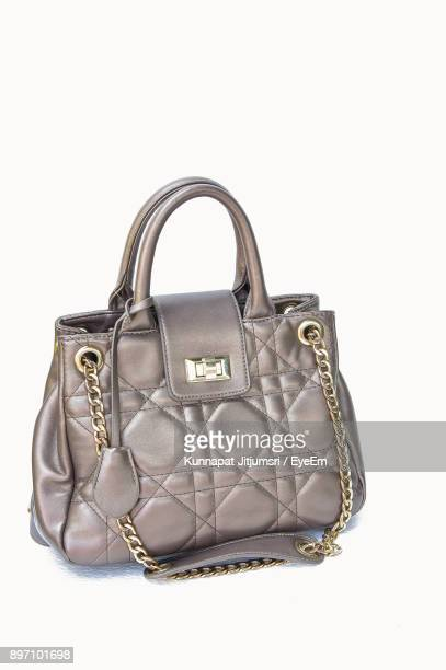 close-up of purse against white background - gray purse stock pictures, royalty-free photos & images