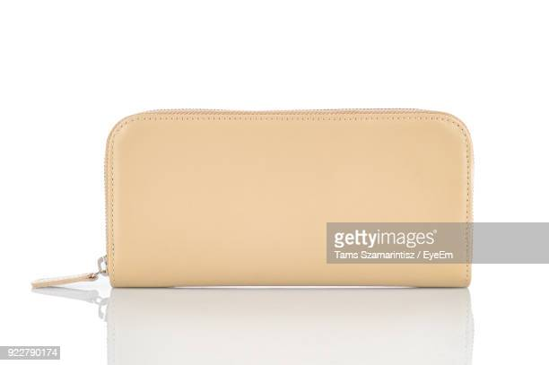 Close-Up Of Purse Against White Background