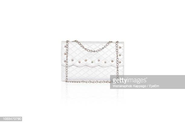 close-up of purse on against white background - white purse stock pictures, royalty-free photos & images