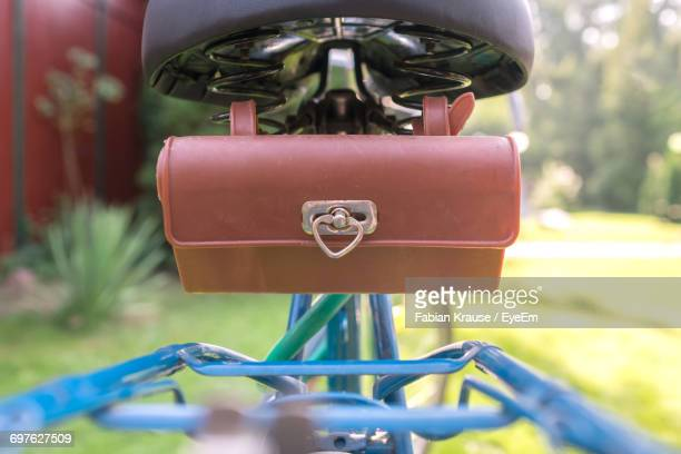 Close-Up Of Purse On Bicycle In Yard