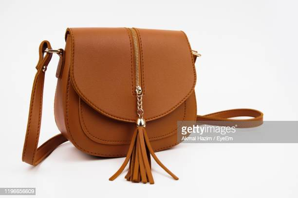 close-up of purse on white background - brown purse stock pictures, royalty-free photos & images