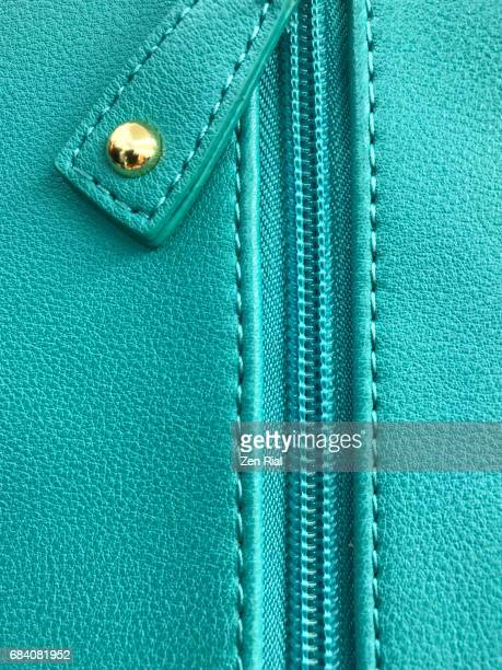 Close-up of purse zipper in turquoise color