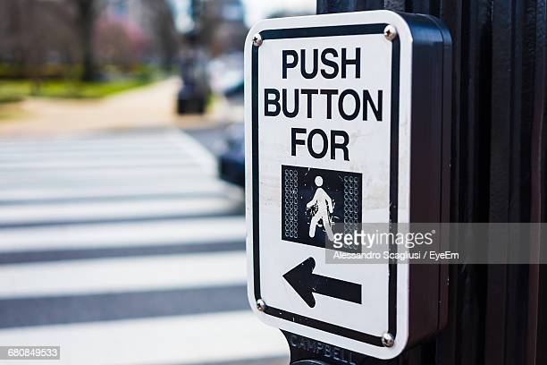 Close-up Of Push Button With Text And Arrow Symbol