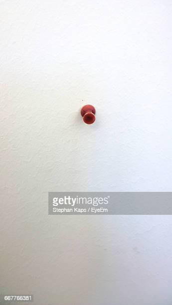 Close-Up Of Push Pin Over White Background