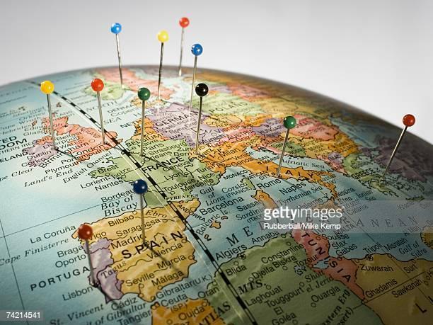 Closeup of pushpins in globe