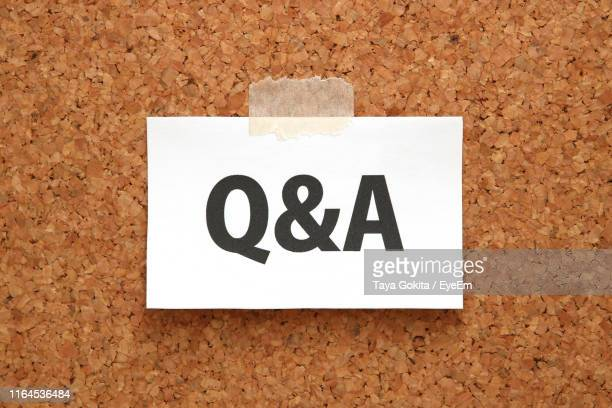 close-up of q and a on paper against wall - q and a stock pictures, royalty-free photos & images