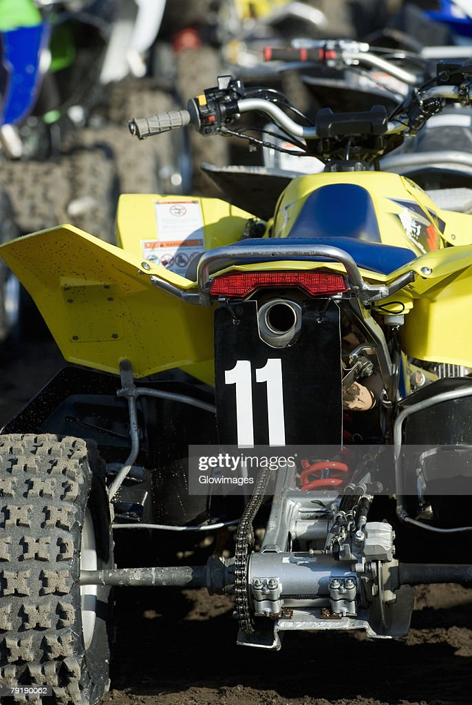Close-up of quadbikes in a row : Foto de stock