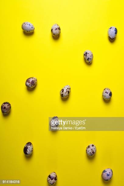 Close-Up Of Quail Eggs Against Yellow Background