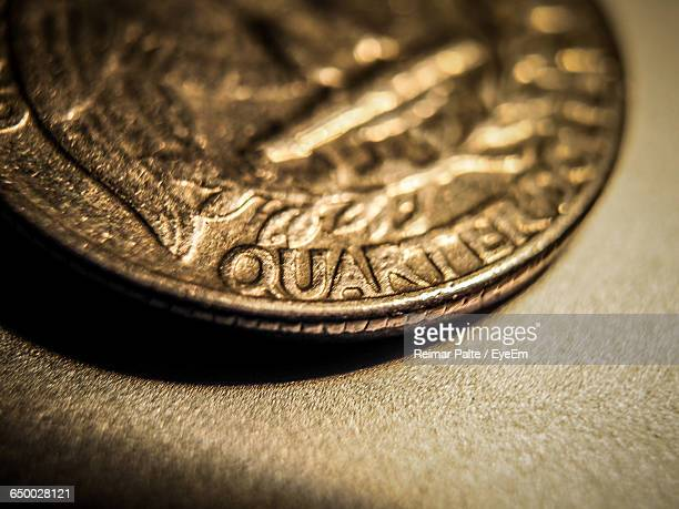 Close-Up Of Quarter Dollar Coin On Table