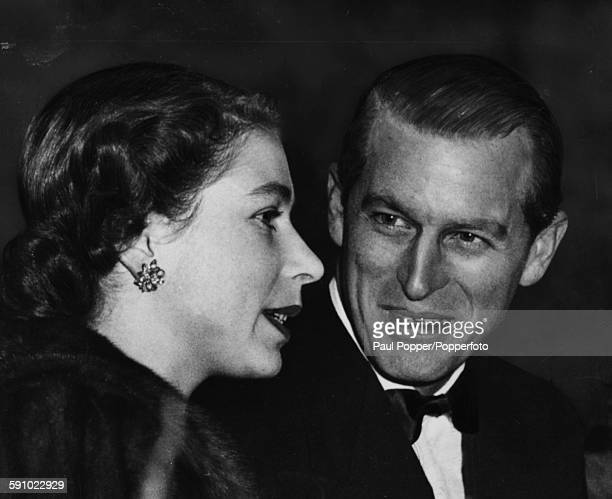 Closeup of Queen Elizabeth II and Prince Philip Duke of Edinburgh talking together in the Royal Box at a performance of Bertram Mills Circus at...