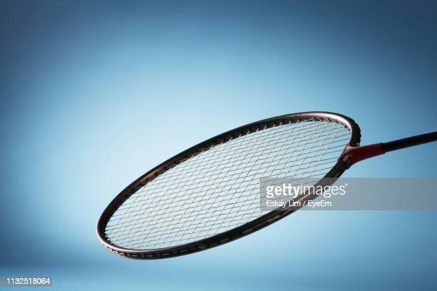 close-up of racket against blue background - badminton sport stock pictures, royalty-free photos & images