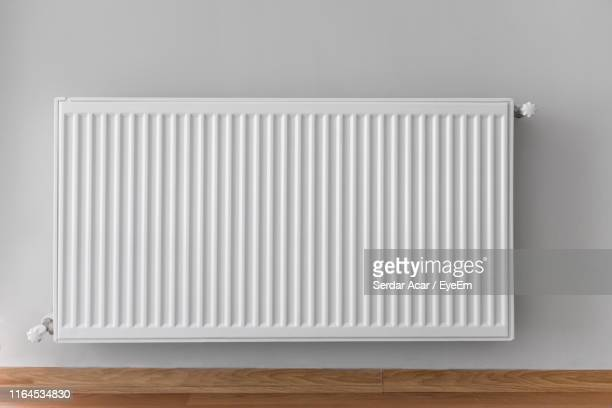 close-up of radiator against wall at home - 暖房用ラジエーター ストックフォトと画像