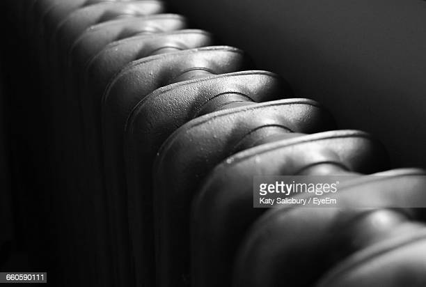 close-up of radiator in darkroom - radiator heater stock photos and pictures