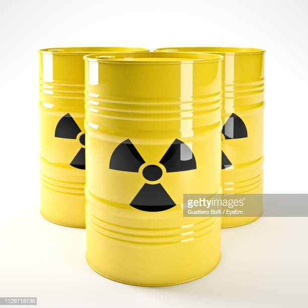 Close-Up Of Radioactive Barrels Against White Background