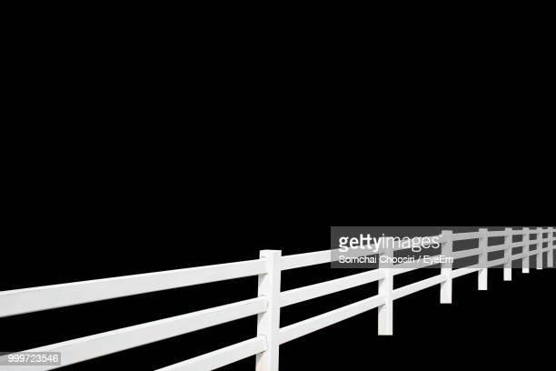 close-up of railing against black background - staccionata foto e immagini stock