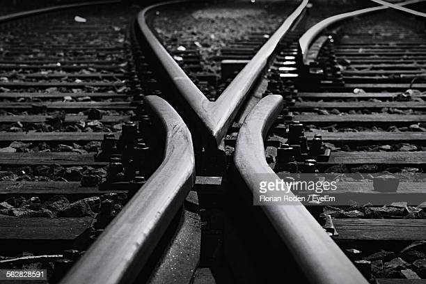 close-up of railroad tracks - crossroad stock pictures, royalty-free photos & images
