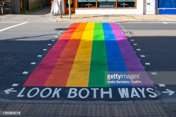 close-up of rainbow painted on road in city - strip stock pictures, royalty-free photos & images