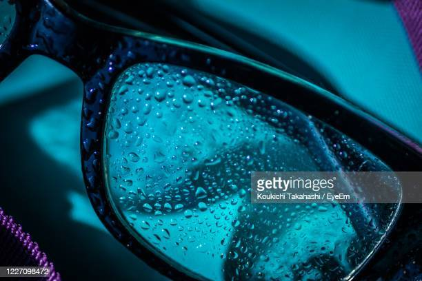 close-up of raindrops on glass - koukichi stock pictures, royalty-free photos & images