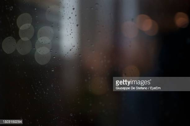 close-up of raindrops on glass window - focus on foreground stock pictures, royalty-free photos & images