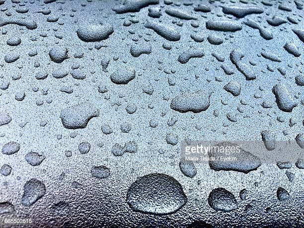 close-up of raindrops on glass window - maria tejada stock pictures, royalty-free photos & images