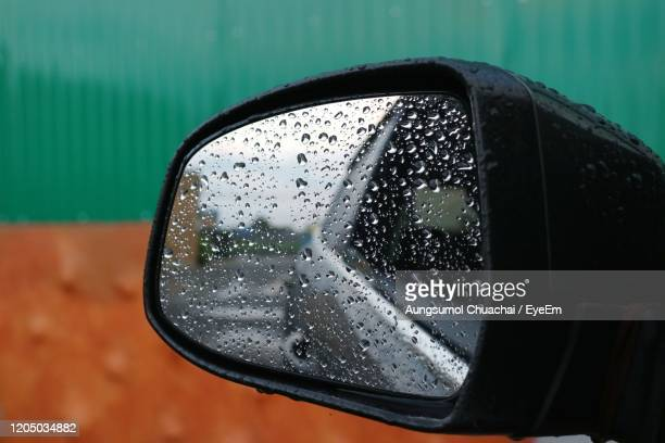 close-up of raindrops on side-view mirror - aungsumol stock pictures, royalty-free photos & images
