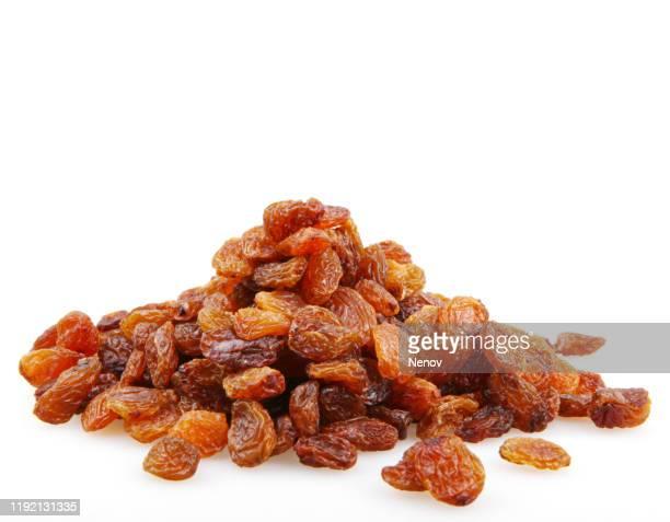 close-up of raisins against white background - passas - fotografias e filmes do acervo