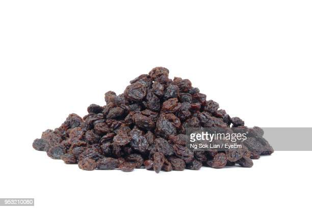 Close-Up Of Raisins Against White Background