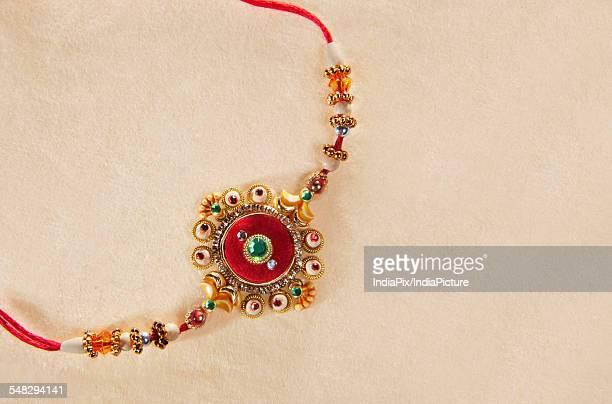 close-up of rakhi - raksha bandhan stock photos and pictures